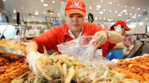 A fishmonger prepares her