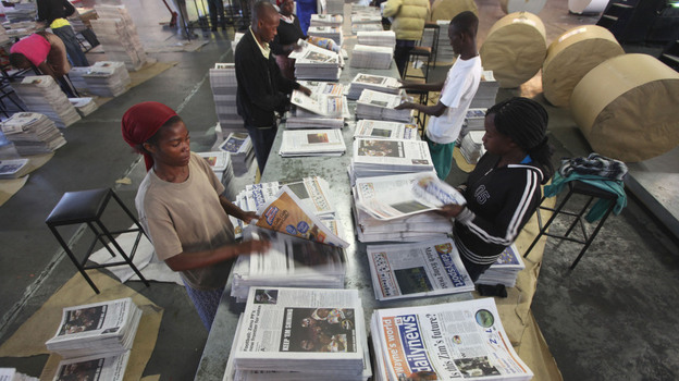 Zimbabwe's government has exercised control over most of the media. Here, workers sort out copies of The Daily News, one of the few independent newspapers. It was allowed to reopen in March 2011 after being shut down for years because it was critical of the government.