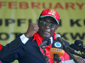 Zimbabwe's President Robert Mugabe is the focus of attention in the state-run media. He is shown here in February in Mutare, speaking at a rally marking his 88th birthday.