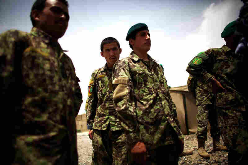 Afghan soldiers prepare for a joint patrol with U.S. Army troops. The Americans are pushing the Afghans to take more responsibility for their own security before the U.S. combat role ends in 2014.