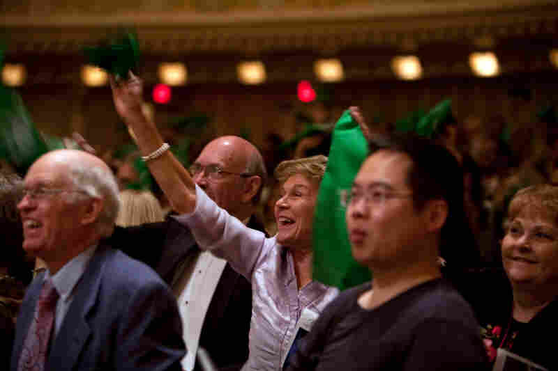 Nashville natives show hometown pride, waving their green handkerchiefs. Over 500 fans traveled from Nashville to hear the hometown band.