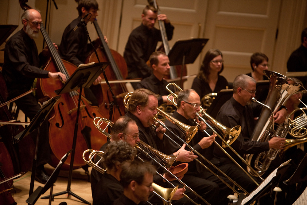 It took another composer, Larry Austin, three decades to complete a version of Ives' unfinished symphony, which calls for a gigantic brass section.