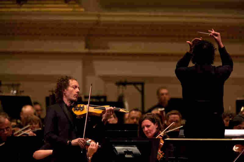 The concert also featured the New York premiere of Terry Riley's The Palmian Chord Ryddle for Electric Violin and Orchestra, a piece he wrote for the soloist, Tracy Silverman. Silverman designed his own six-string instrument that reaches down into the cello range.