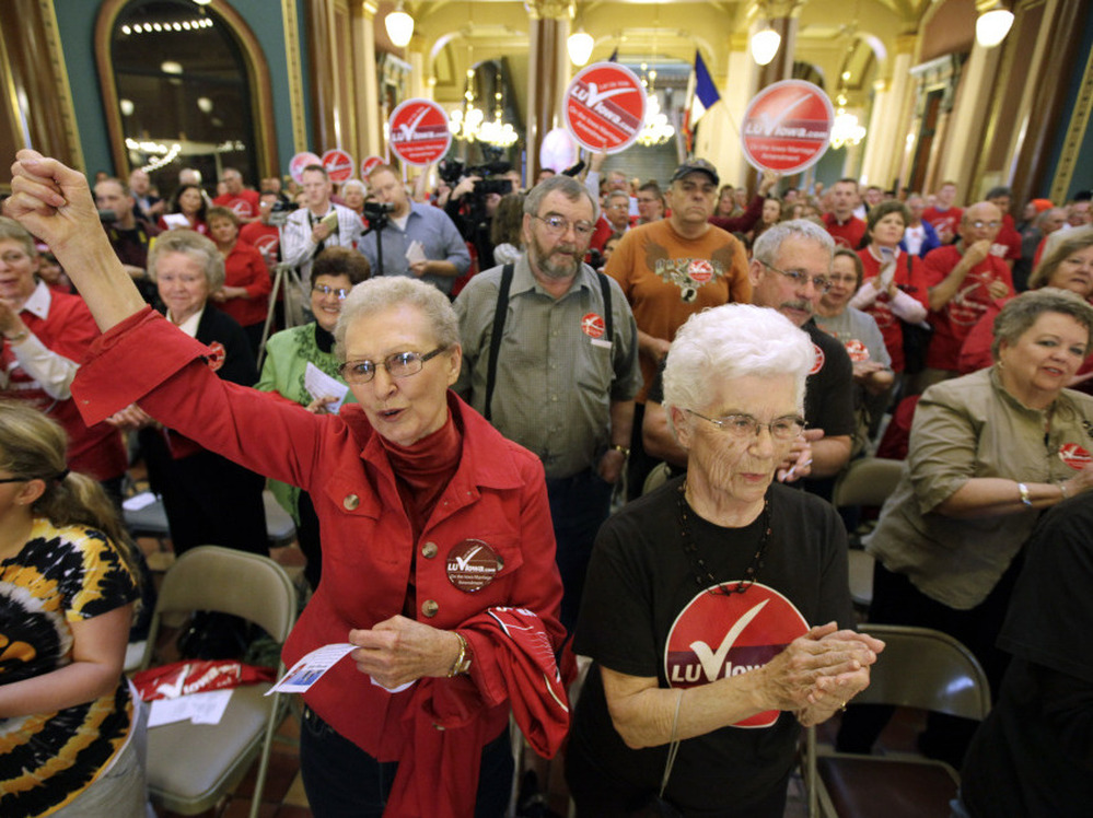 Iowans attend a marriage rally sponsored by The Family Leader on Tuesday at the Statehouse in Des Moines. The head of the organization says President Obama's endorsement of gay marriage could cost him the election.