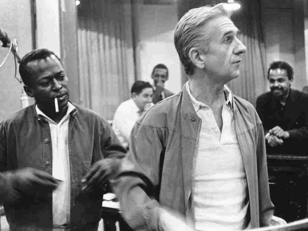 Gil Evans in the studio with Miles Davis, circa 1970.
