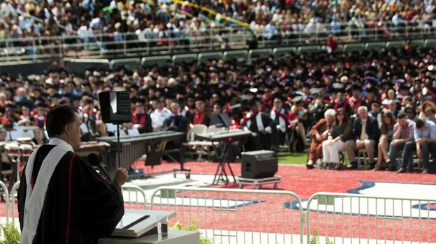 """Mitt Romney delivers the keynote address at Liberty University's commencement ceremony in Lynchburg, Va., on Saturday. In his speech, Romney told students that """"marriage is a relationship between one man and one woman."""" (AFP/Getty Images)"""