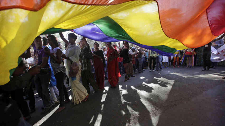 Participants carry a rainbow flag during a gay, lesbian, bisexual and transgender parad
