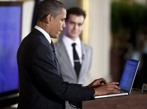 President Barack Obama posts a Tweet during an online Twitter town hall meeting from the East Room of the White House July 6, 2011 in Washington, DC. A strong online presence was one strength of the president's campaign during the 2008 election.
