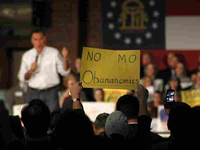 An audience member decries President Obama's economic policies as Republican presidential candidate Mitt Romney speaks during a February campaign rally in Atlanta.