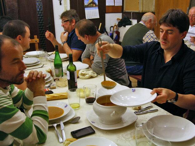 Enrique Vallejo serves soup at the Amaikak Bat txoko in San Sebastian.