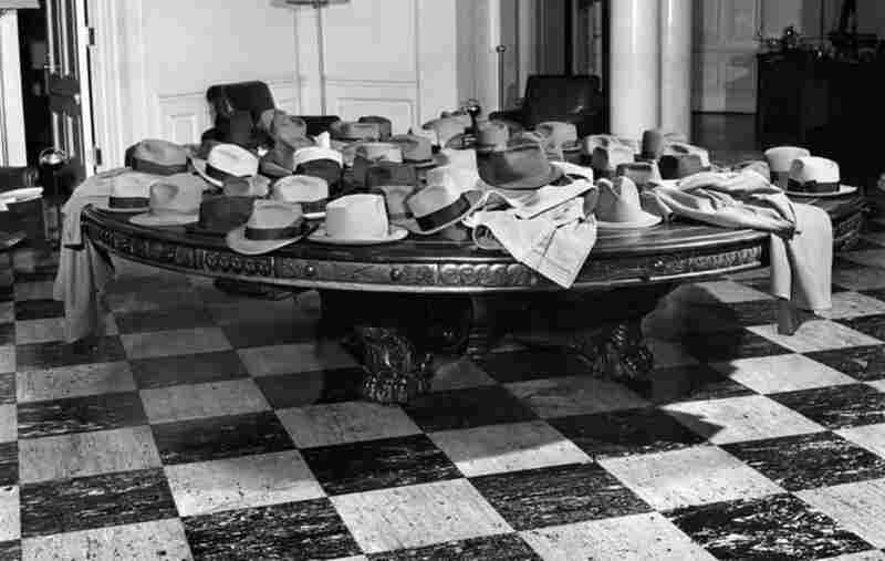 """April 28, 1948: This photo ran as part of a two-page photo essay about the """"Washington scene."""" The hats, piled on an 8-foot mahogany table in the lobby of the East Wing of the White House, were deemed """"a barometer of presidential activity,"""" the caption read. """"This collection was deposited by a delegation of magazine editors who obtained an appointment with the president."""""""