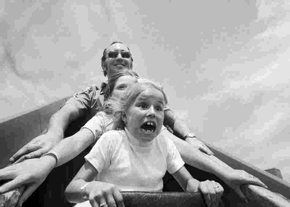 Aug. 2, 1976: Doreen Haviland (front) rides a roller coaster at Coney Island at the 40th annual Police Anchor Club outing for the widows and children of deceased police officers.