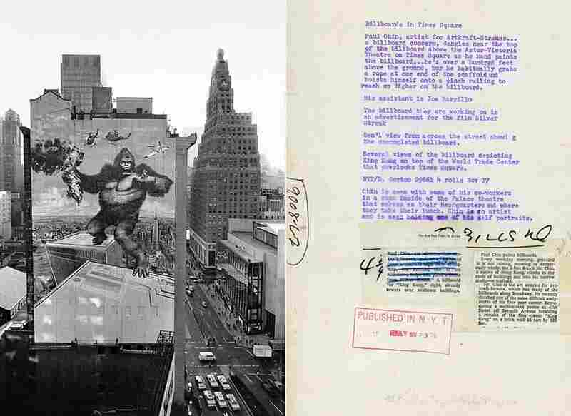"""Nov. 17, 1976: """"Paul Chin paints billboards,"""" reads the article accompanying this photograph. """"Every weekday morning, provided it is not raining, snowing or dangerously windy, the 5-feet 6-inch Mr. Chin, a native of Hong Kong, climbs to the roofs of buildings and into his narrow studio — a scaffold."""" Chin, art director for Artkraft Strauss, created this King Kong billboard towering over Midtown."""