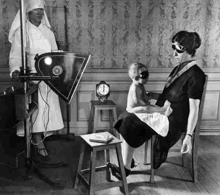 """1928: This image was used in the Mid-Week Pictorial on Aug. 18 to illustrate a treatment in Paris for children """"suffering from rickets or other maladies common to city children unable to have the healing rays of the sun."""""""