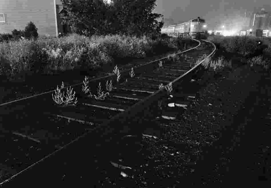 July 29, 1971: A Penn Central train on weed-choked tracks along the little-used Upper Harlem Valley line. The railroad's plans to eliminate service north of Dover Plains in Dutchess County, New York, were met with opposition. But the end of the line came anyway, in March 1972.