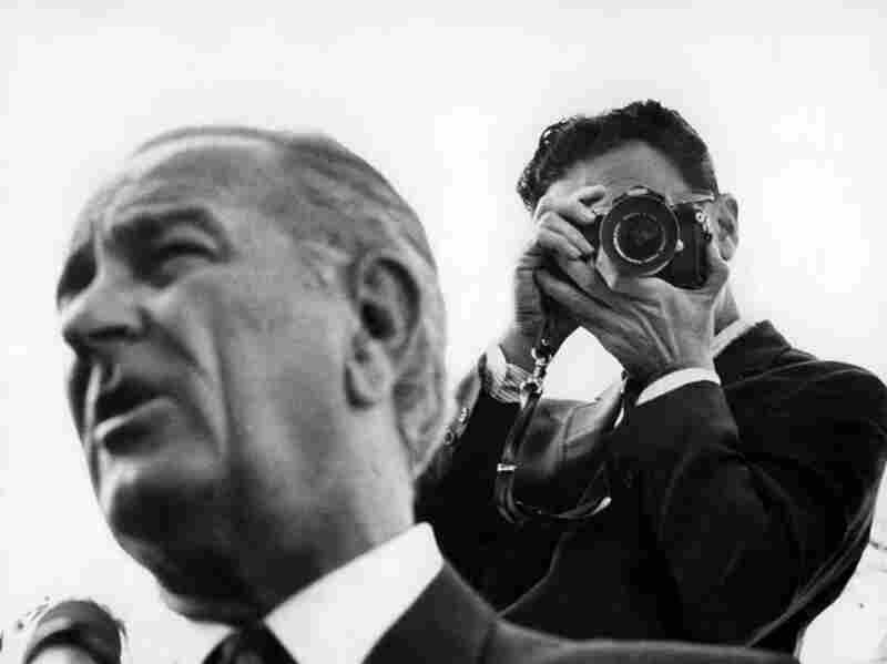 """Nov. 23, 1968: The Times wrote about White House photographer Yoichi Robert Okamoto (right), who produced most of the photos of President Lyndon B. Johnson at the time. The reporter wrote, """"Some persons are appalled by the size and expense of Mr. Johnson's picture operation. Others believe the price is little enough to pay for pictures that will be priceless to historians."""""""