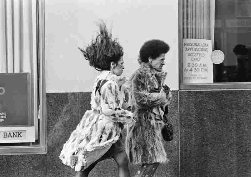 "Nov. 26, 1974: Fulton Street off Church Street in Manhattan on a 30-degree day with wind speeds reaching 43 mph. The photo ran with the headline, ""Gusty Decision: Hold On Or Let Fly."""
