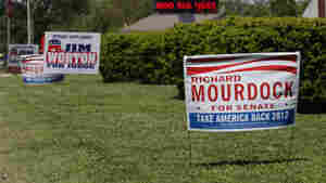 Yard signs supporting U.S. Senate candidate Richard Mourdock in Columbus, Ind., on April 23. Mourdock went on to beat incumbent Sen. Dick Lugar in a primary race that received national attention, and a flood of money from outside Indiana.