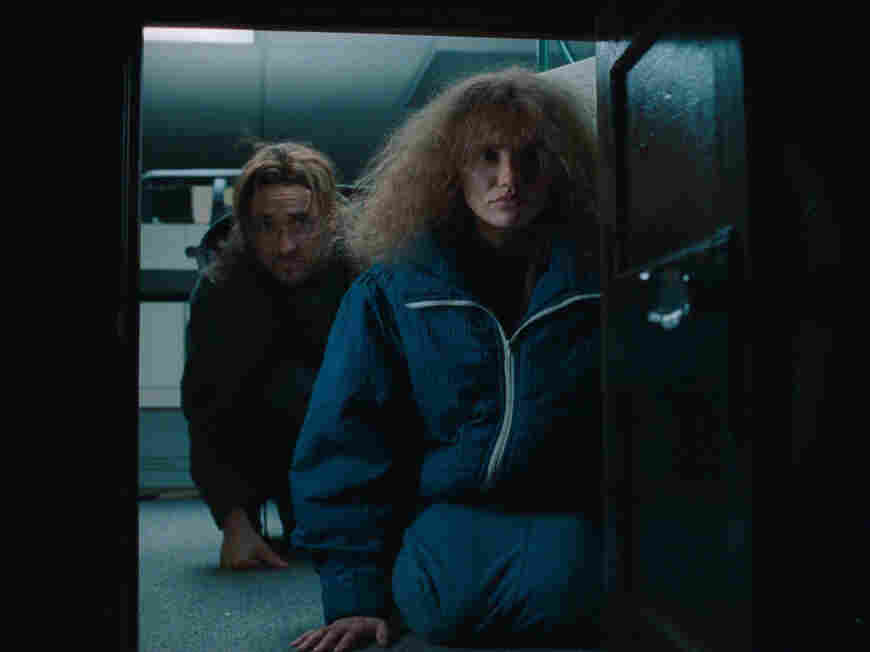 John Cusack and Cameron Diaz in Being John Malkovich.