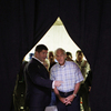 Rep. Ron Paul, R-Texas (right), talks with chief strategist Jesse Benton in Ames, Iowa, on Aug. 13.