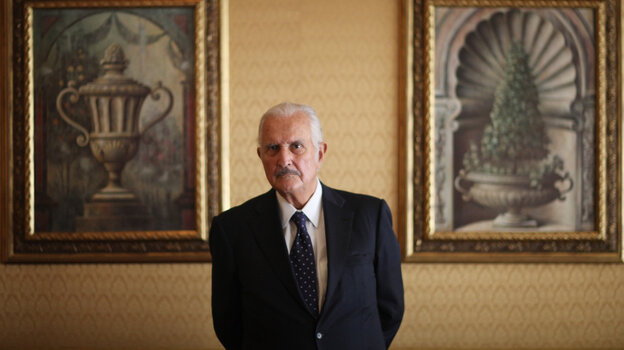 Mexican author Carlos Fuentes poses for a photo after a news conferen