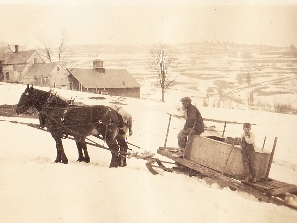 Perkins Flint and son Gardner collect sap, Braintree Hill, Vt., circa 1938 (Vermont Folklife Center)