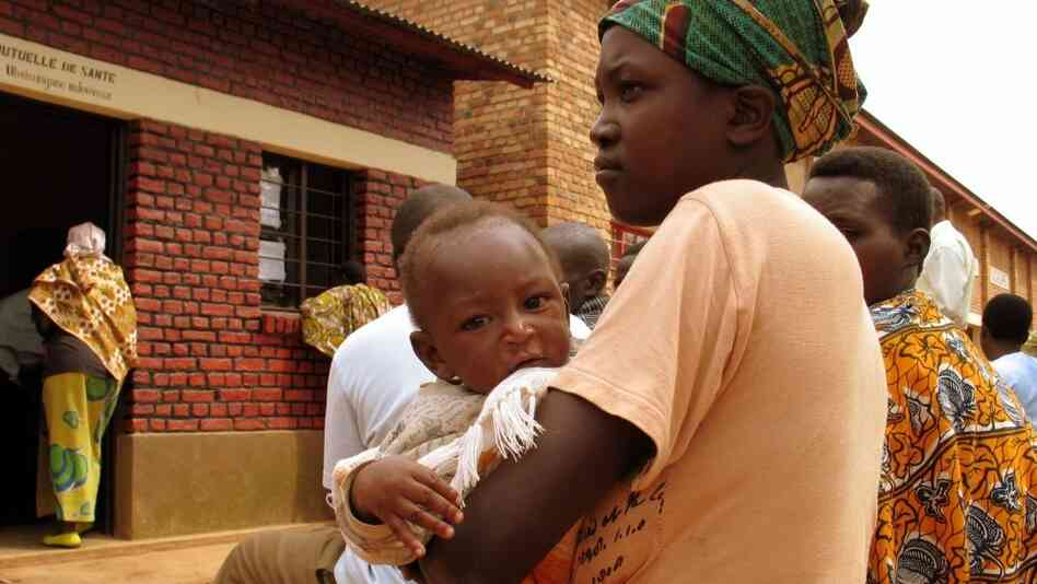 A mother and child wait to receive treatment at the HIV clinic in Nyagasambu, Rwanda, in Feb. 2008. The clinic was built by the Washington-based Elizabeth Glaser Pediatric AIDS Foundation with a grant from the PEPFAR pr