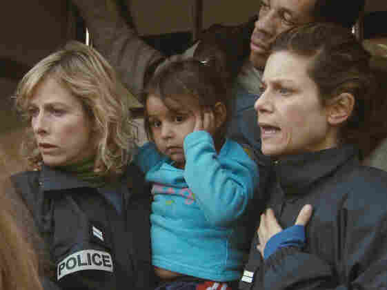 With Iris (Marina Fois, right) and Fred (Joey Starr), Nadine (Karin Viard) carries a Romanian child from a crime scene.