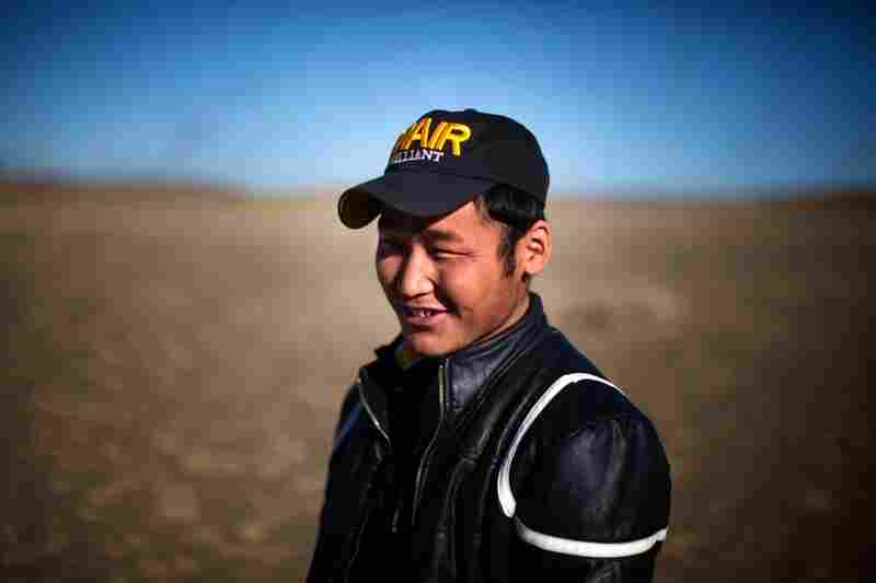 Uuganbaatar says does not miss the herding life of his father and enjoys the salary, friends and amenities at the mining camp.