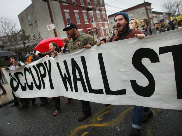 Occupy Wall Street protesters march through in an impoverished community in December 2011.