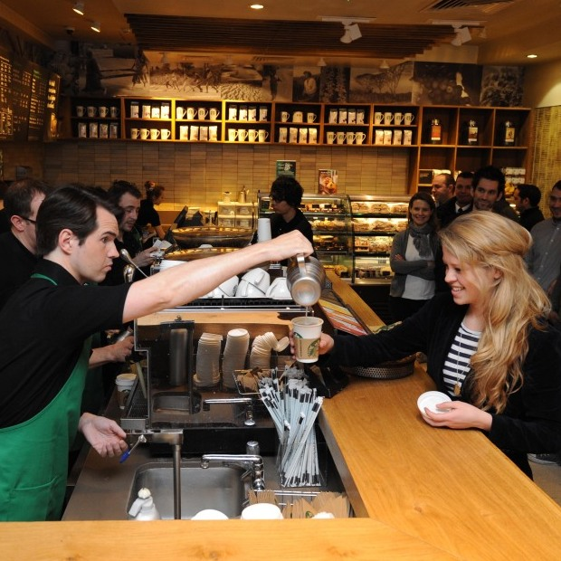 A customer tries a new latte at Starbucks in London, England. A new study shows people who drink coffee may live a little longer.
