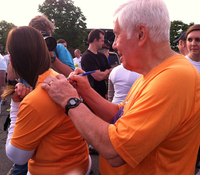 Sen. Lugar signs an autograph at the Capital Challenge race.