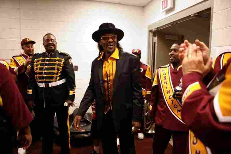 Brown became a fixture at events in the nation's capitol. Here, he greets members of the Washington Redskins Marching Band before a game in 2010.