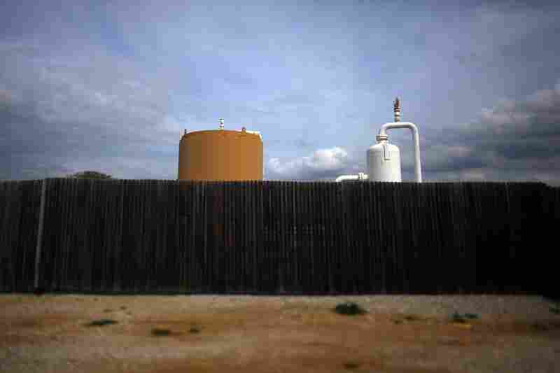 Energy companies surround some well sites with wooden fencing to cut down on the industrial feel of their operations.
