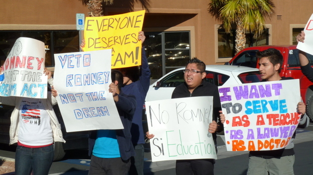 Latinos protest Mitt Romney's opposition to the Dream Act, outside his campaign headquarters in Las Vegas on Feb 2. (AFP/Getty Images)