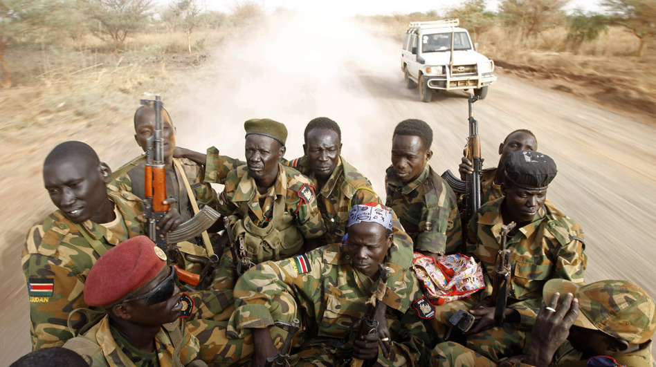 South Sudanese soldiers travel near the front line with Sudan last month. The two sides have clashed repeatedly in recent weeks.