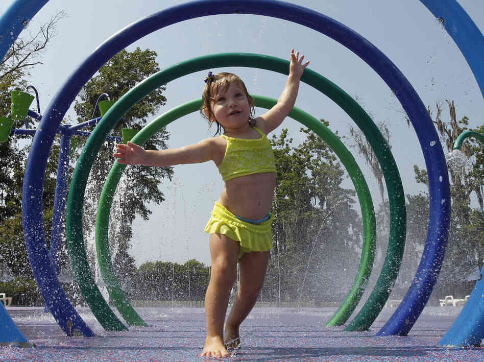 Alivia Parker, 21 months at the time, ran through circles of spraying water on a hot day i