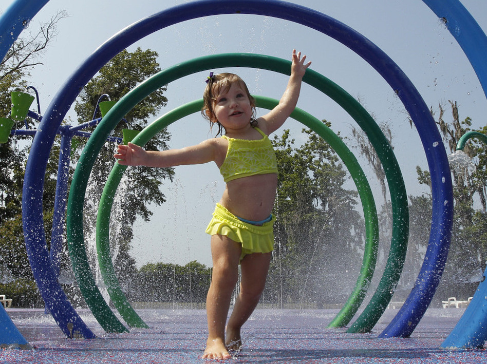 Alivia Parker, 21 months at the time, ran through circles of spraying water on a hot day in Montgomery, Ala., last June. She was wearing sunscreen with an SPF of 100, a rating that won't be allowed much longer. (Dave Martin/AP)