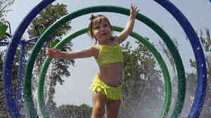 Alivia Parker, 21 months at the time, ran through circles of spraying water on a hot day in Montgomery, Ala., l