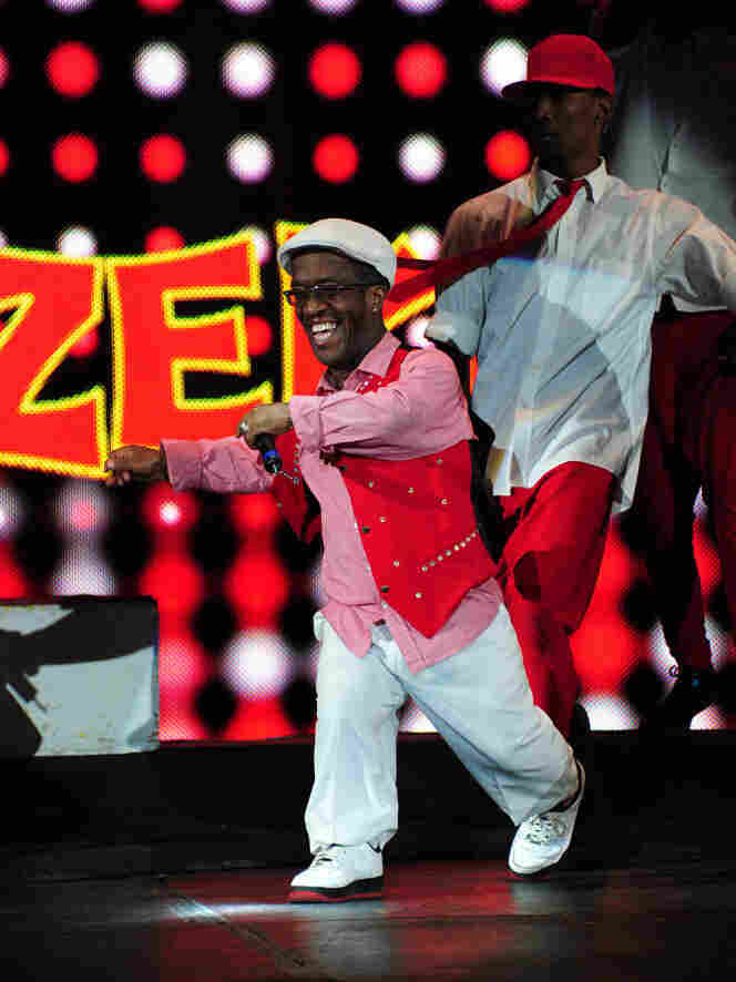 """Zanda """"Zeke"""" Charles began as UniverSoul's ringmaster sidekick 18 years ago. Today, he co-hosts the show, and, when not in the ring, he roams the audience signing autographs and giving out hugs."""