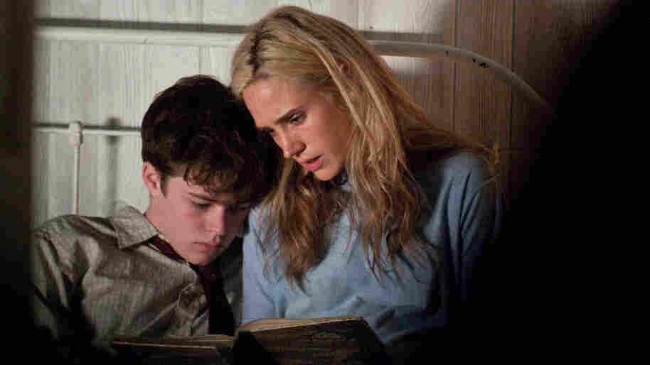 Single mother Virginina (Jennifer Connelly) reads with her son, Emmett (Harrison Gilbertson), who remains devoted to her even when her ill-advised affair with the married sheriff of their small Virginia town puts pressure on her family.