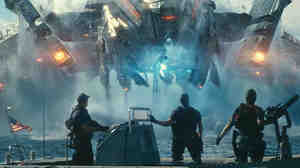 Beast (John Tui), Hopper (Taylor Kitsch) and Raikes (Rihanna) are stunned by the appearance of invading alien forces in the motion picture adaption of the, yes, board game Battleship.