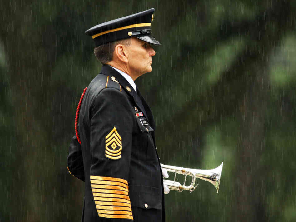 A lone bugler stands at attention in the rain at Wilmington National Cemetery in North Carolina, in 2009.