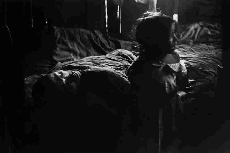 Isabel Beside Sick Father, Rio de Janeiro, Brazil, 1961