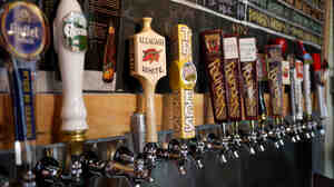 A row of taps highlights specialty and imported beers at Brouwerij Lane, in Brooklyn, New York. Craft brewers have found a way to thrive, even as t