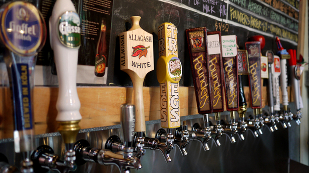 A row of taps highlights specialty and imported beers at Brouwerij Lane, in Brooklyn, New York. Craft brewers have found a way to thrive, even as the U.S. economy struggles. (NPR)