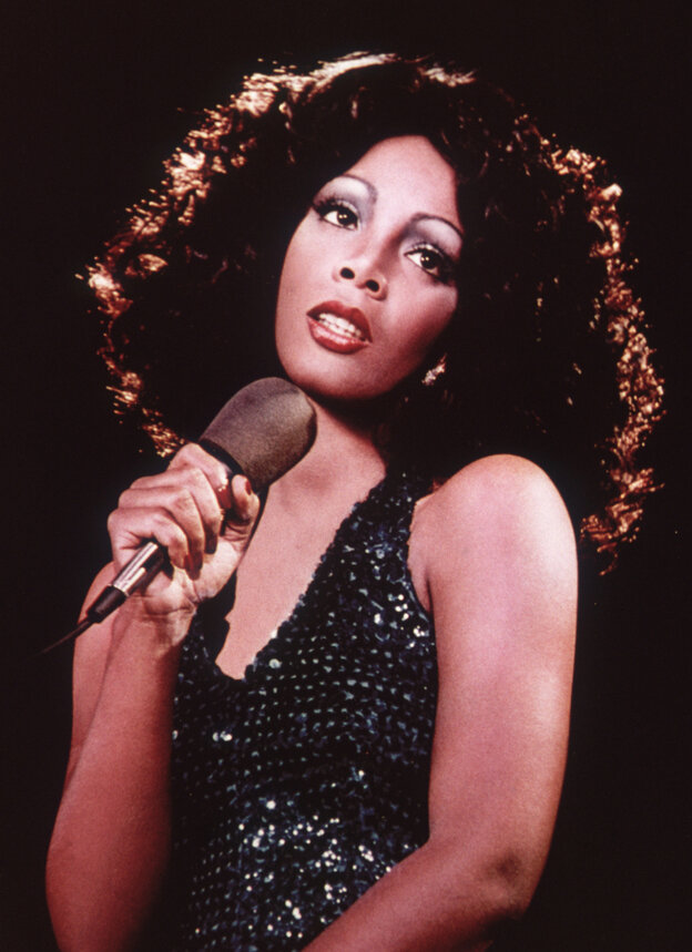 Disco singer Donna Summer singing on stage around 1975.
