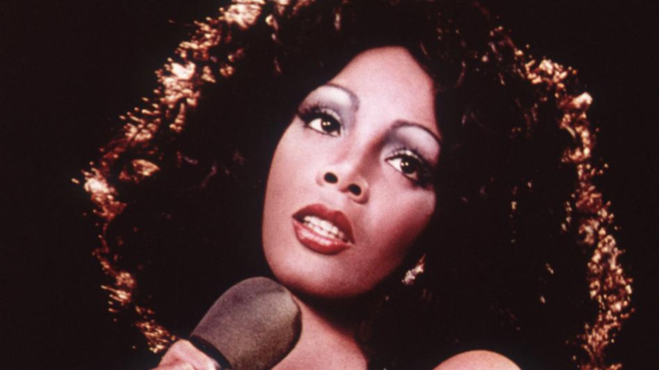 Disco singer Donna Summer singing on stage around 1975. (Getty Images)