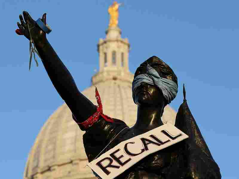 A sign to recall Wisconsin Governor Scott Walker hangs on a statue in front of the Wisconsin State Capitol on March 10, 2011 in Madison, Wisconsin.