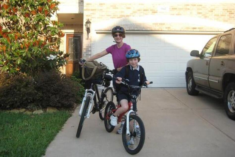 "Jennifer Drake and her daughter, Alex, pause before their morning ride. ""My daughter and I bike to school (her work) 3 miles roundtrip daily,"" Drake writes."